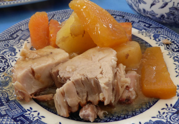slow cooker pork leg in apple juice close up