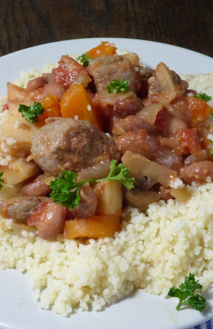 slow cooker sausage and bean chilli on couscous from busylizziecooks.com