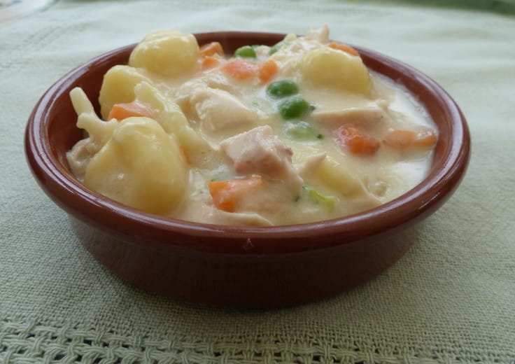 A close up of a small dish of creamy chicken gnocchi from busylizziecooks.com