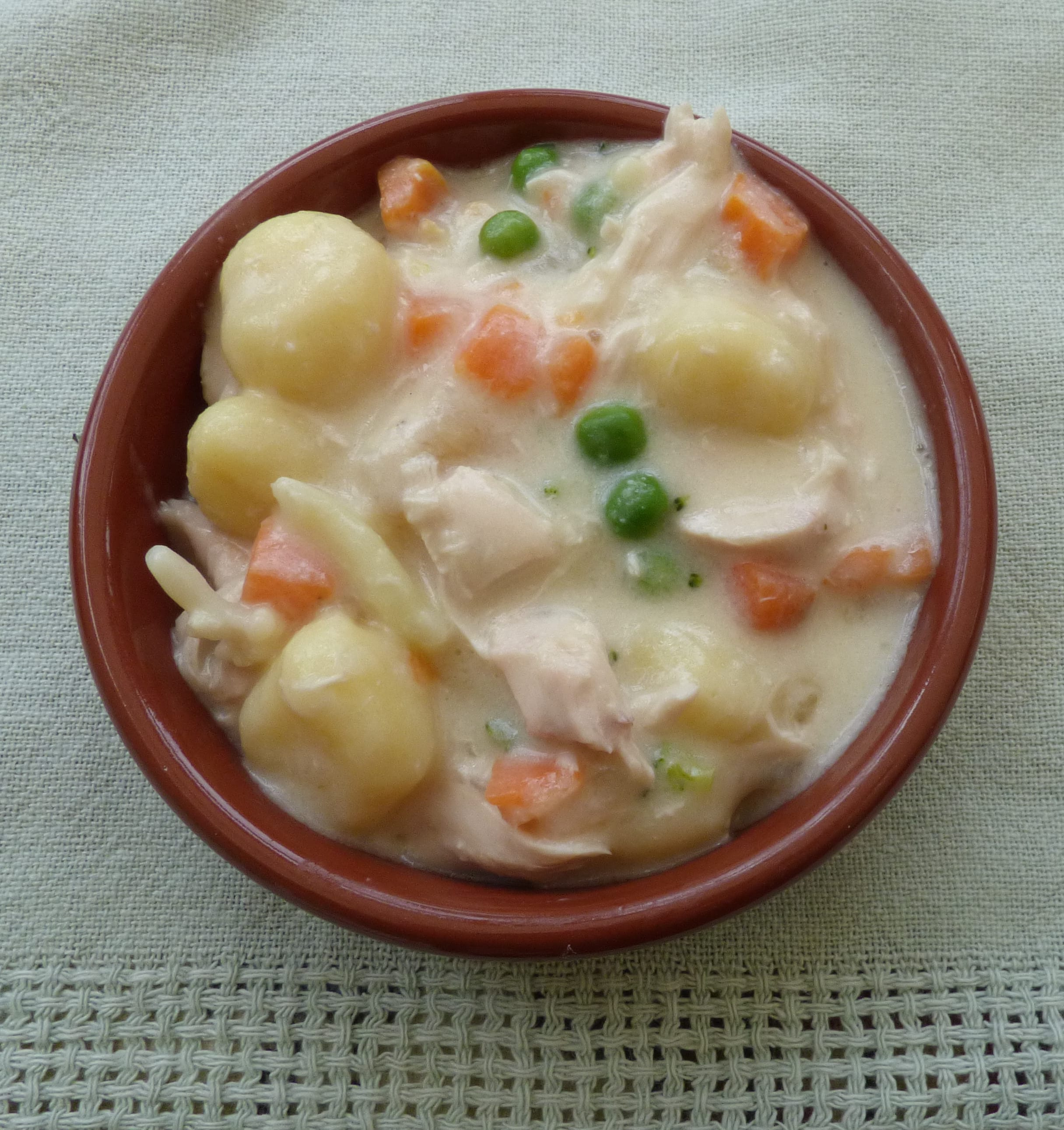 A small dish of creamy chicken gnocchi from busylizziecooks.com