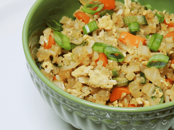 Bowl of cauliflower fried rice with scallion garnish - 20 minute dinner idea