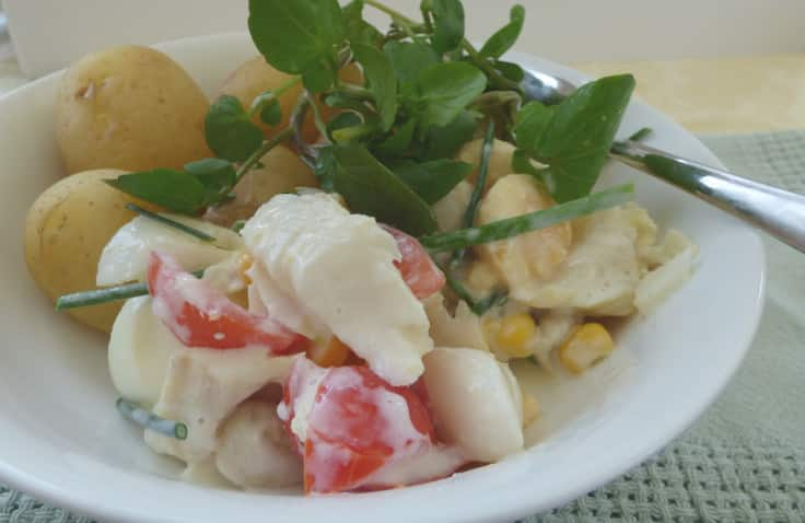 Plate of smoked haddock salad with potatoes and watercress garnish, from busylizziecooks.com
