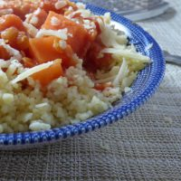 lentil chilli with couscous and grated cheese