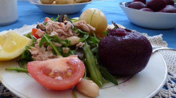 Tuna beetroot salad with beans close up