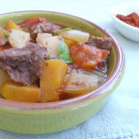 Dish of Slow Cooker Venison Goulash with Basil Garnish