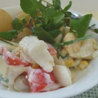 Plate of smoked haddock salad with potatoes and watercress garnish, from busylizziecooks.com